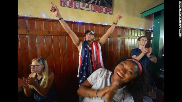 U.S. fans Jon Gonzalez, center and Angie Plummer, front, have mixed reactions throughout the U.S. vs. Germany match at Zeppelin Hall Restaurant and Biergarten in Jersey City, New Jersey.