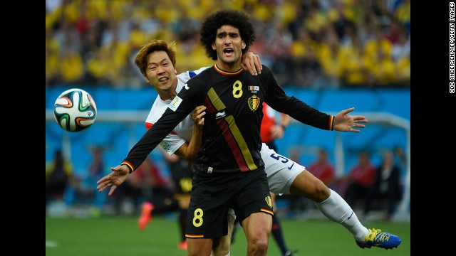 Young-Gwon, left, vies with Belgium midfielder Marouane Fellaini.