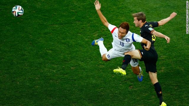 Nicolas Lombaerts of Belgium challenges Kim Shin-Wook of South Korea.