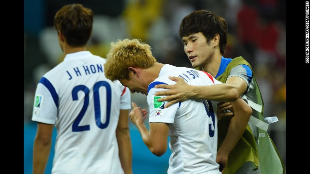South Korea midfielder Son Heung-Min, center, reacts after losing to Belgium during a World Cup match at the Corinthians Arena in Sao Paulo, Brazil. Belgium won 1-0.