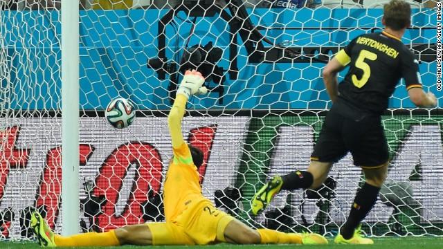 Belgium defender Jan Vertonghen, right, scores
