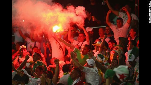 Algeria fans celebrate their team's first goal.