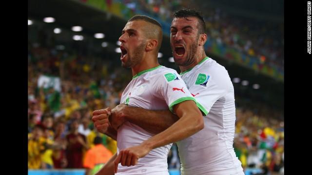 Islam Slimani of Algeria, left, celebrates scoring his team's first goal with Essaid Belkalem.