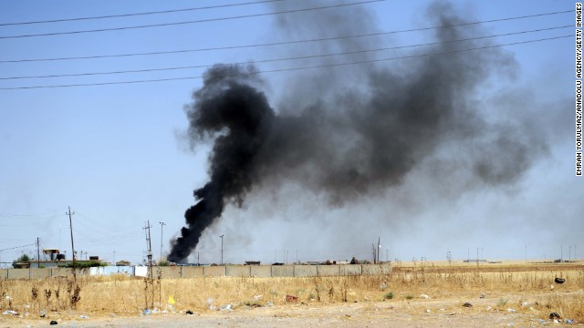 Smoke rises in the Karakus district of Mosul as clashes between Iraqi forces and ISIS militants take place on June 26.
