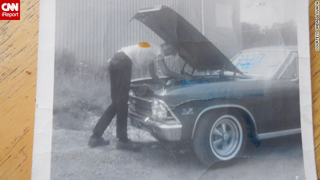 """Back then, not everyone had a car. So if a guy did, he was considered way cool,"" <a href='http://ireport.cnn.com/docs/DOC-1141387'>Linda Glovach </a>said. This is a photo of her boyfriend tending to his 1966 Chevrolet Chevelle in Elmont, New York, in 1967."