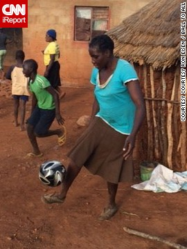"""Imagine you drive to the middle of nowhere to deliver soccer balls to kids who never had one,"" said Ron Eisen. ""After you make the delivery, a woman appears, without shoes, and has mad soccer skills!"" Eisen, a volunteer with the charity Ball To All, photographed the woman in Shangani, Zimbabwe, as she demonstrated her prowess. He <a href='http://ireport.cnn.com/docs/DOC-1144199'>made a video</a>, too.<!-- --> </br>"