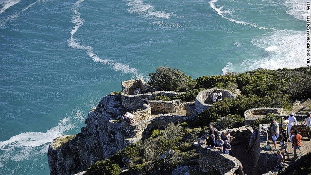 Another stop is the Cape Point, a World Heritage Site whose 200 meter high sheer cliffs cut deep into the mixing waters of Atlantic and Indian Oceans.