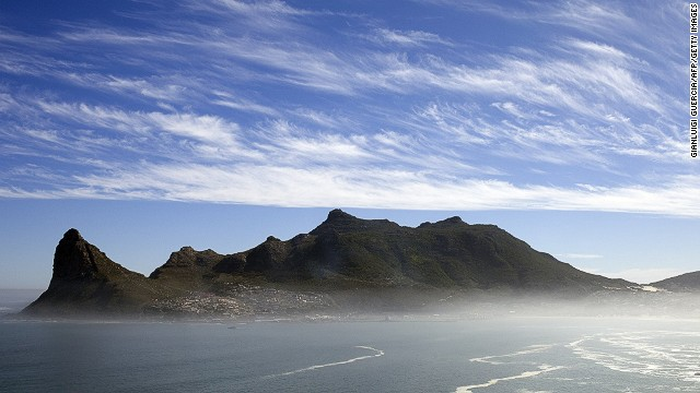 He decided to leave the corporate world after his bank wanted him to relocate, and used the payout from his job to start a new venture as a tour guide. Seen here is the view of Hout Bay Harbor from the Chapman's peak road on the outskirts of Cape Town, one of the stops on Escape to the Cape tour.