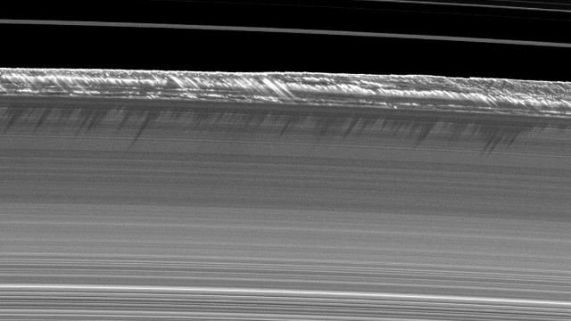 7. Vertical structures in the rings imaged for the first time. Once about every 15 years, the sun shines on the edge of the ring plane and northern and southern sides of the rings receive little sunlight. Cassini measured the thick, long shadows from this rare event to determine the heights of structures within the rings.