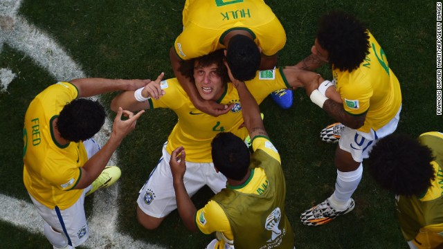 Brazil's defender David Luiz, center, celebrates with teammates after scoring a goal.