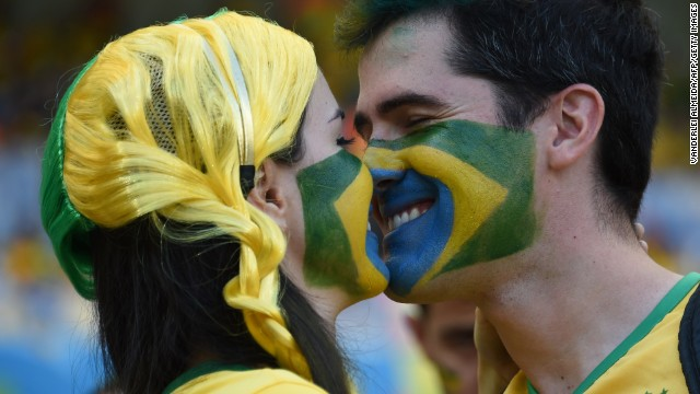 Brazil fans kiss before the start of the game. See the best World Cup photos from June 26.