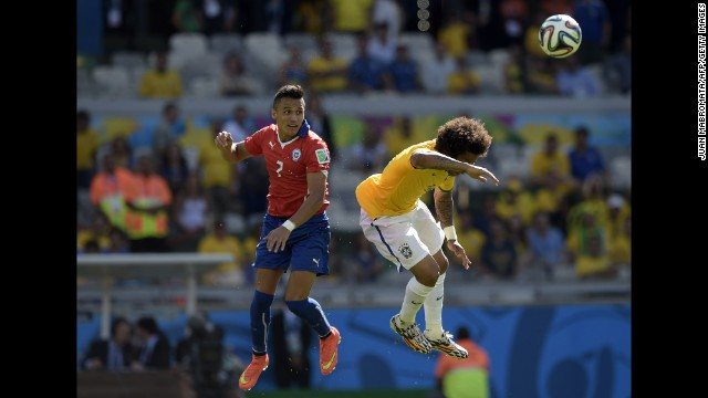 Chile's Alexis Sanchez, left, and Brazil's Marcelo jump for the ball.