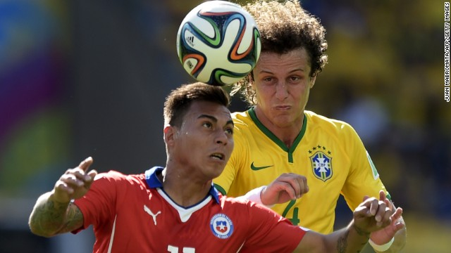Chile's Jorge Valdivia and Brazil's David Luiz vie for the ball.