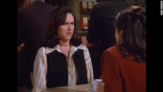 "<strong>Molly Shannon </strong>plays Elaine's co-worker, Sam, a woman who doesn't move her arms when she walks. In the season eight episode, Sam sees Elaine making fun of her and trashes Elaine's office and leaves her crazy voice mails. Shannon is known for her work on ""Saturday Night Live."""