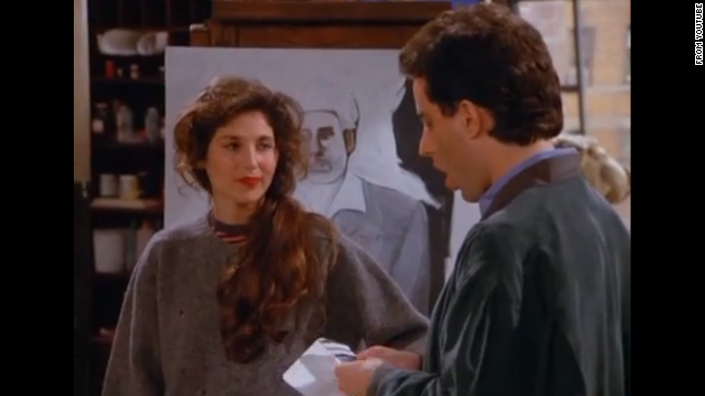 "<strong>Catherine Keener </strong>plays Jerry's new girlfriend Nina for an episode in season three. Nina is an artist who paints Kramer as ""a loathsome, offensive brute,"" and yet you cannot look away. Nina's father then offers the crew Yankee tickets in the owner's box. But things unravel for the couple at the game when Elaine is ejected from the seats for refusing to remove her Baltimore Orioles cap. Keener has appeared in multiple roles since, although her most famous part may be as Trish Piedmont in ""The 40 Year Old Virgin."""