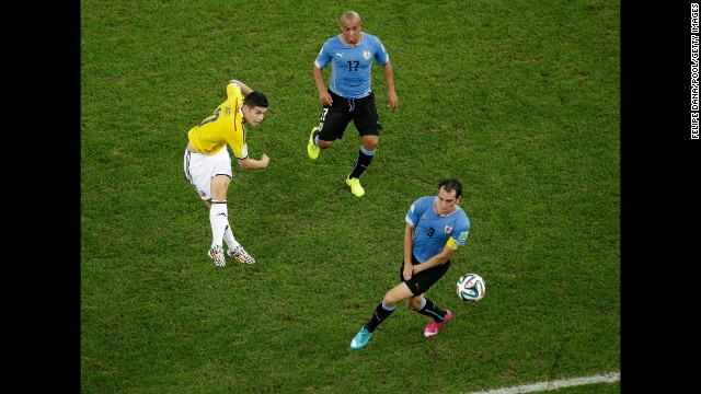 Rodriguez shoots and scores his team's first goal against Uruguay.