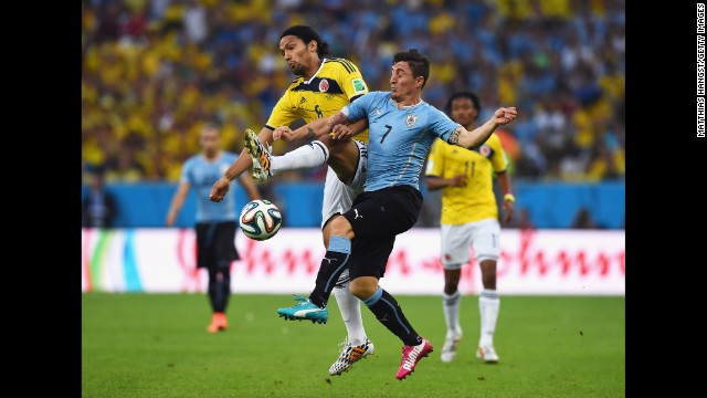 Abel Aguilar of Colombia and Cristian Rodriguez of Uruguay compete for the ball.