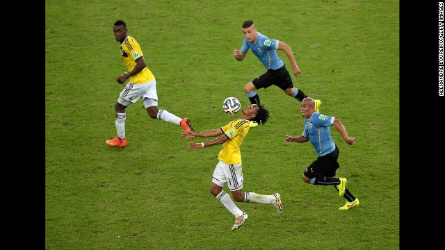 Juan Guillermo Cuadrado of Colombia controls the ball.