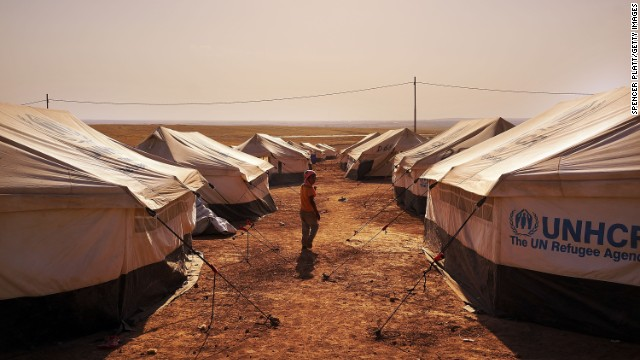 An Iraqi child walks through a displacement camp Saturday, June 28, in Khazair, Iraq.