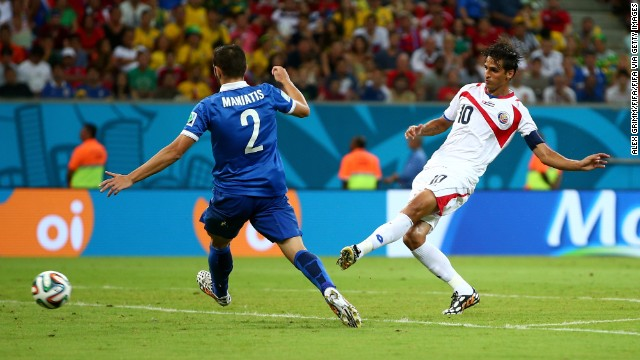 Bryan Ruiz of Costa Rica scores his team's goal against Greece.