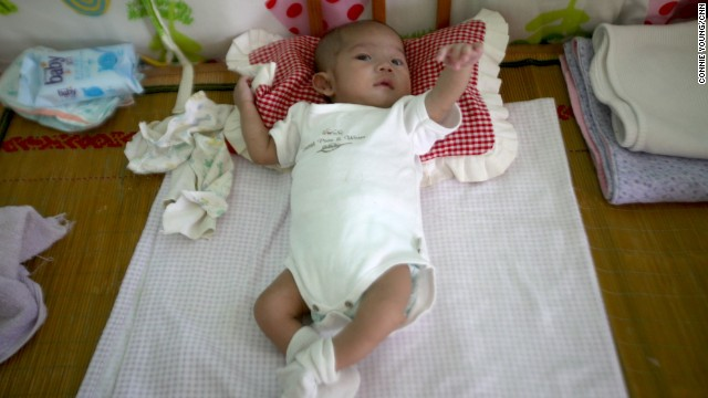 A 4 month-old baby recovering from heart surgery at Shepherd's Field, a foster home near Tianjin. The foster home accepts babies from state orphanages across China offering medical treatment.
