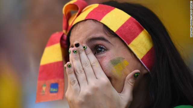 A fan in Rio de Janeiro shows her emotions as she watches the penalty shootout between Brazil and Chile on June 28. Brazil was victorious.
