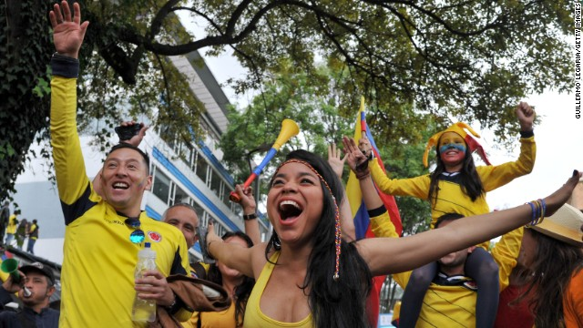 Fans in Bogota, Colombia, celebrate during the live broadcast of Colombia's World Cup win over Uruguay on Saturday, June 28.