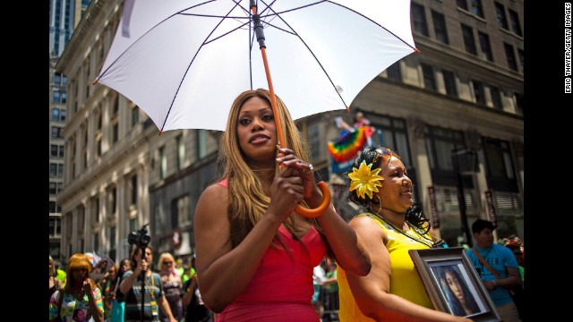 Grand Marshal Laverne Cox, left, and Delores Nettles, mother of <a href='http://www.cnn.com/2013/08/24/us/new-york-transgender-woman-death/'>slain transgender woman Islan Nettles</a>, march in the parade.