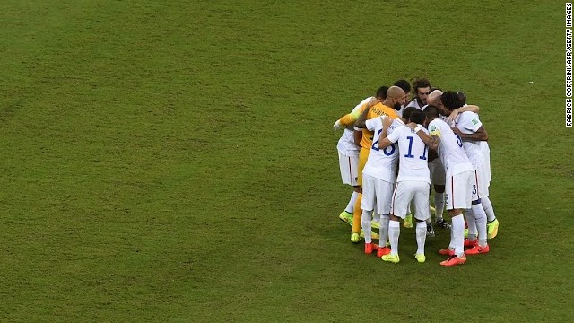 Team USA huddles before kickoff against Portugal.