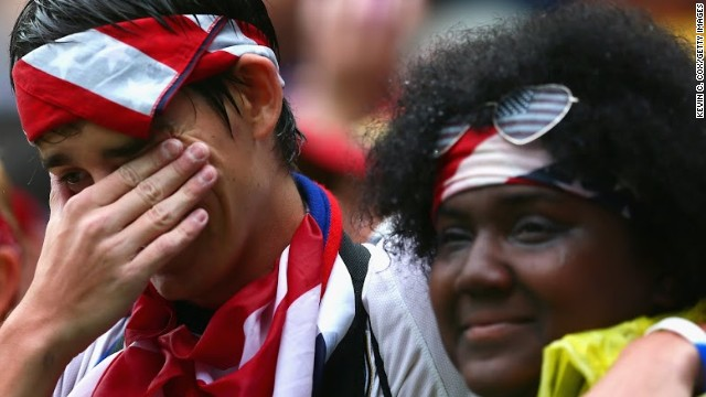 A fan sheds tears of joy after the U.S. reached the knockout stages of the World Cup.