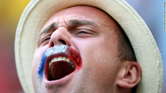 A France fan cheers before the game. <a href='http://www.cnn.com/2014/06/29/football/gallery/world-cup-0629/index.html'>See the best World Cup photos from June 29</a>