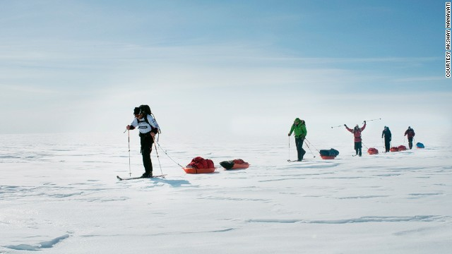 He dragged a 190-pound sled with full of supplies across the ice and snow of Greenland. Some sections were completed on skis.