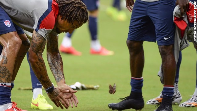 Taking time out of training, Jermaine Jones tries to catch a butterfly in the Arena Amazonia in Manaus.