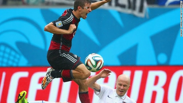 Michael Bradley battles for the ball with Germany's match-winner Thomas Muller.