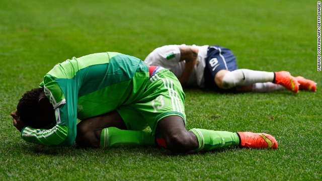 Oshaniwa and Valbuena lie on the field injured.
