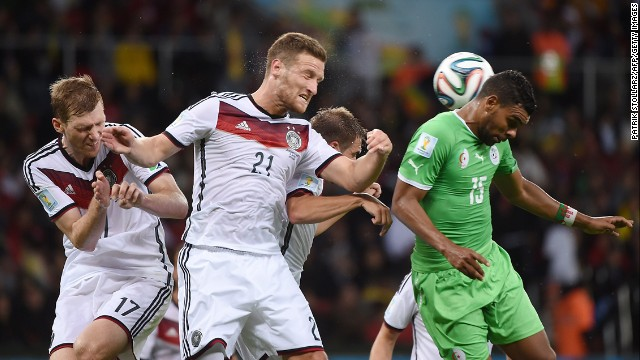 German defenders Per Mertesacker, left, and Shkodran Mustafi, second from left, take on Algeria's El Arabi Soudani.