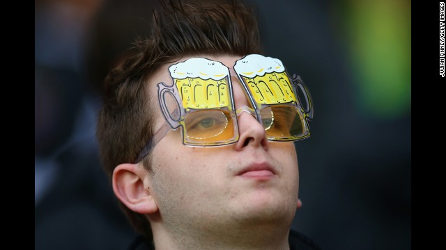 A fan looks on prior to the match between Germany and Algeria.