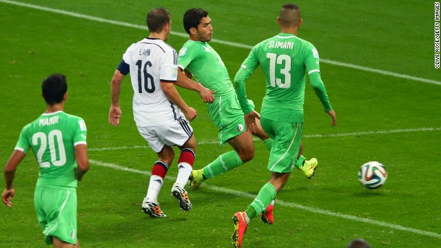Abdelmoumene Djabou of Algeria shoots and scores his team's first goal in extra time during a World Cup round-of-16 match against Germany on Monday, June 30, in Porto Alegre, Brazil. Despite the late goal, Germany still advanced to the quarterfinals with a 2-1 victory.