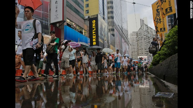 Rain poured down upon protesters intermittently throughout the day.