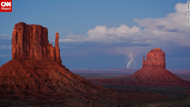 "Monument Valley on the Arizona-Utah line is known for its sandstone formations and vast desert views.<a href='http://ireport.cnn.com/docs/DOC-1145480'> Toby Dingle</a> photographed lightning striking, ""an amazing thing to witness,"" last September."