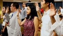 The author, Moni Basu, center, says the Pledge of Allegiance at her naturalization ceremony in 2008.