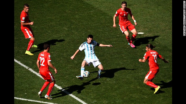 Swiss players surround Messi in the first half.