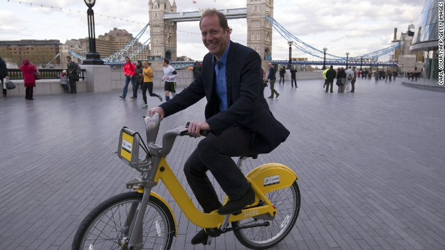 Christian Prudhomme, director of the Tour de France, rides one of the 101 specially designed bikes that have been put into circulation to celebrate the Tour coming to England.