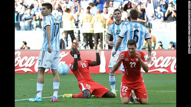 Switzerland defenders Fabian Schaer, right, and Johan Djourou, second from left, react after a missed shot.