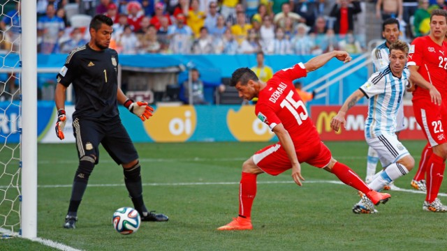 Blerim Dzemaili of Switzerland heads the ball off the post late in extra time.