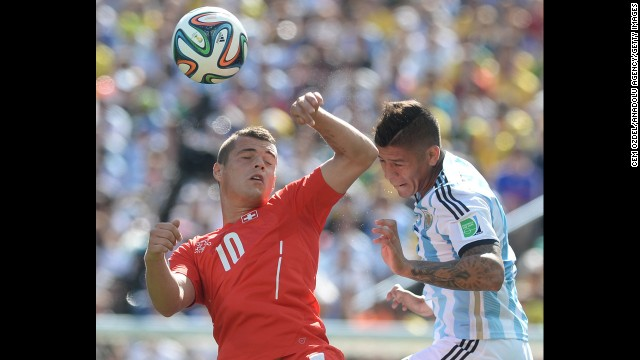 Marcos Rojo of Argentina, right, fights for the ball against Granit Xhaka of Switzerland.