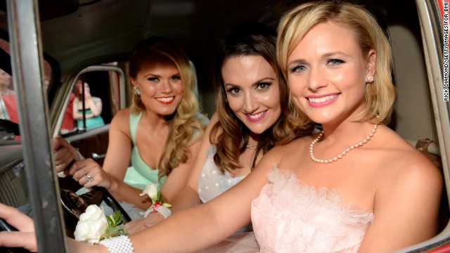 "Miranda Lambert is celebrating the success of her album ""Platinum"" with a new look. The singer, far right, showed off a cropped haircut Monday, June 30, at a party celebrating her hit song ""Automatic"" going No. 1. To her right are ""Automatic"" co-writers Natalie Hemby and Nicolle Galyon."