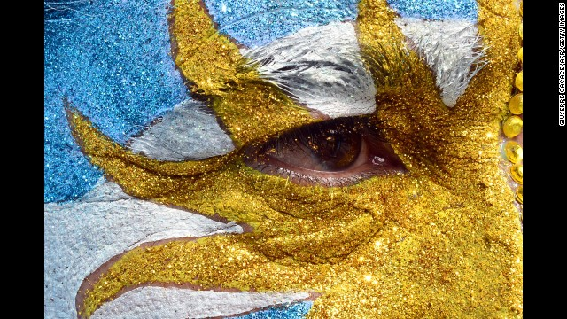 An Argentina fan with face paint watches the game at Copacabana beach in Rio de Janeiro.