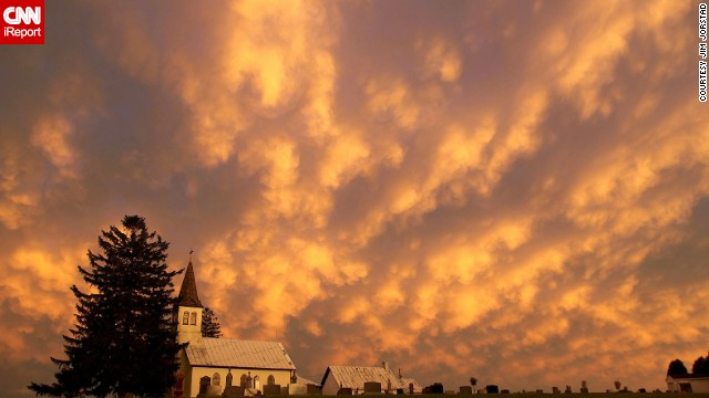 "Jim Jorstad felt he was ""in another world"" when he looked up and saw <a href='http://ireport.cnn.com/docs/DOC-1148956'>these heaping cloud formations</a> in late June from the Mississippi River shore in LaCrosse, Wisconsin. The rolling clouds are known as mammatus clouds and typically associated with strong thunderstorms, according to the National Weather Service."