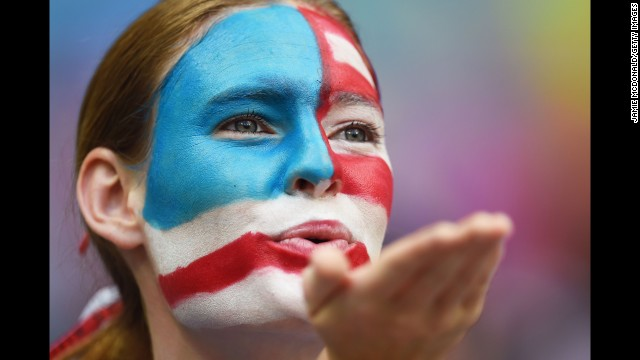 A U.S. fan blows a kiss.